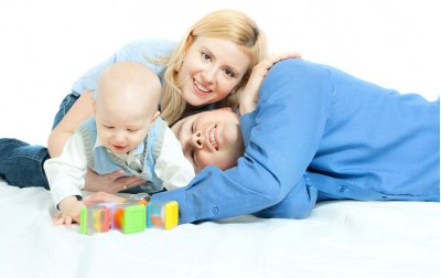 baby-boy-with-parents-playing