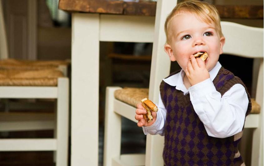 toddler-boy-eating-biscuit